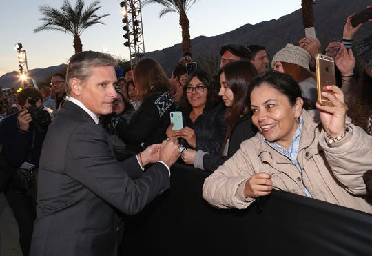 Viggo Mortensen signs autographs for fans at the Palm Springs International Film Festival Awards Gala, January 3, 2019.