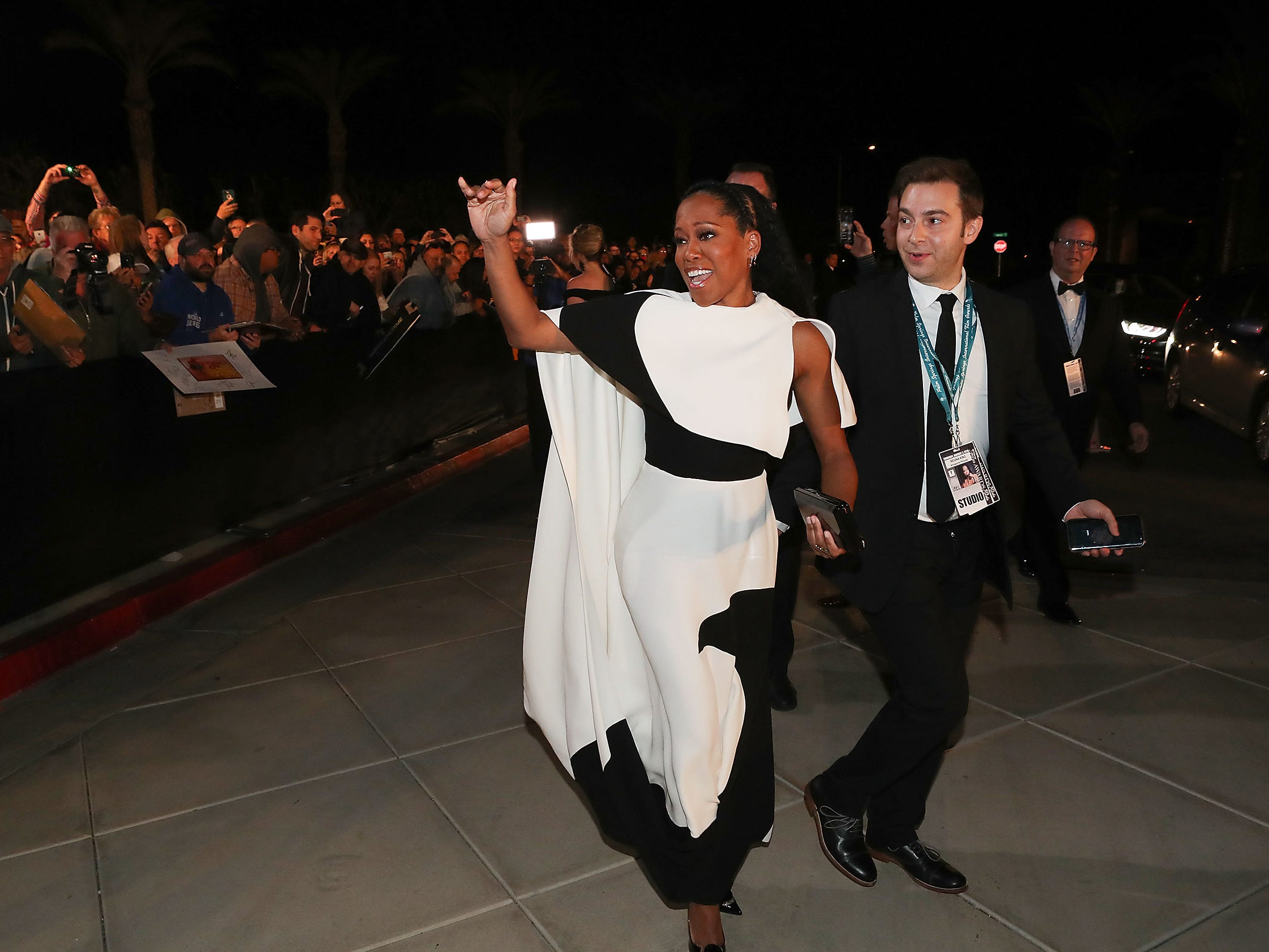 Regina King waves to fans at the Palm Springs International Film Festival Awards Gala, January 3, 2019.