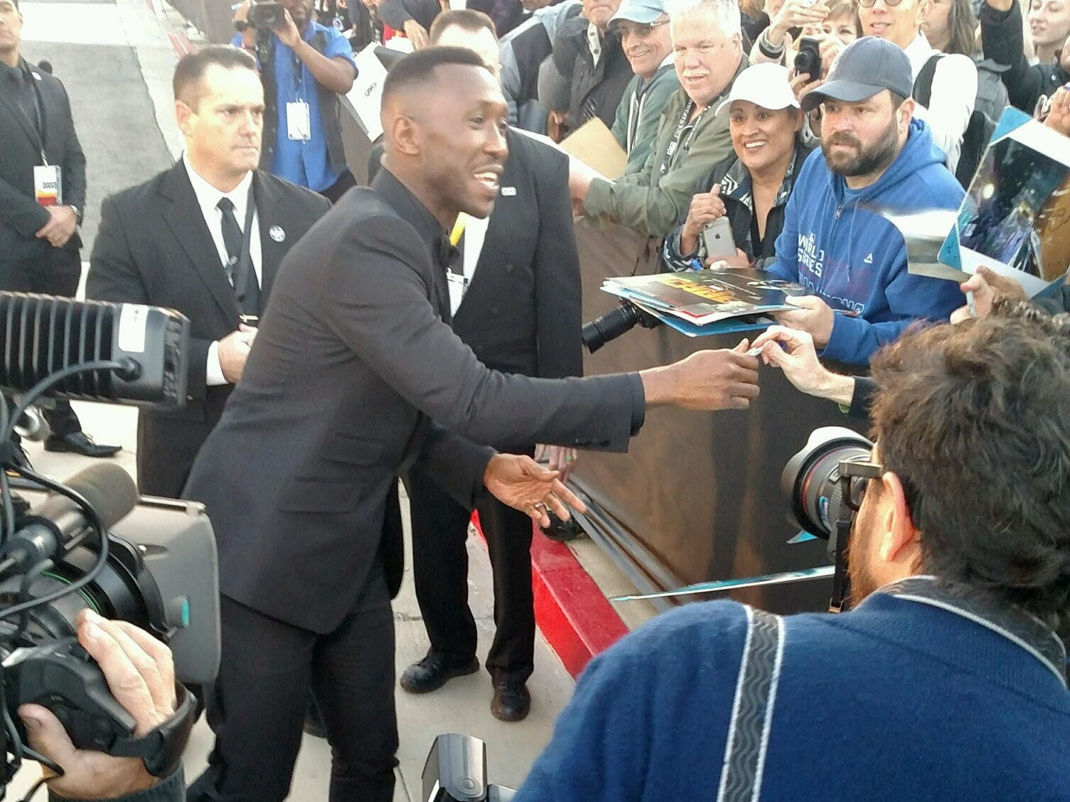 """""""Green Book"""" star Mahershala Ali is greet by autograph seekers Thursday outside the Palm Springs Convention Center. The cast and director of Green Book are receiving the Palm Springs International Film Festival  Vanguard Award at the Film Awards Gala."""