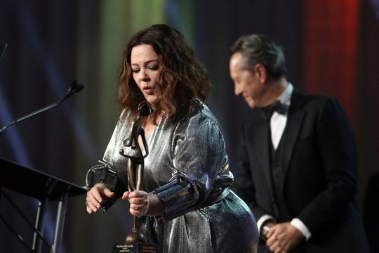 Melissa McCarthy sets down her Spotlight Actress Award on Thursday, January 3, 2018 at the Palm Springs International Film Festival Gala in Palm Springs.