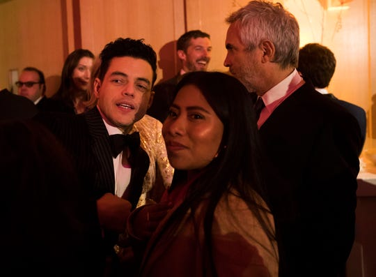 From left, Rami Malek and Yalitza Aparicio Martinez enjoy a moment at the Palm Springs International Film Festival after-party at Parker Palm Springs