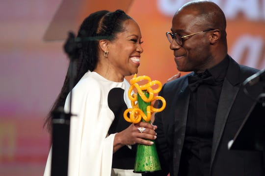 Regina King is awarded the Chairman's Award presented to her by Barry Jenkins on Thursday, January 3, 2018 at the Palm Springs International Film Festival Gala in Palm Springs.