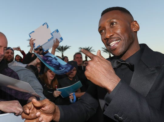 Ali Mahershala signs autographs for fans at the Palm Springs International Film Festival Awards Gala, January 3, 2019.