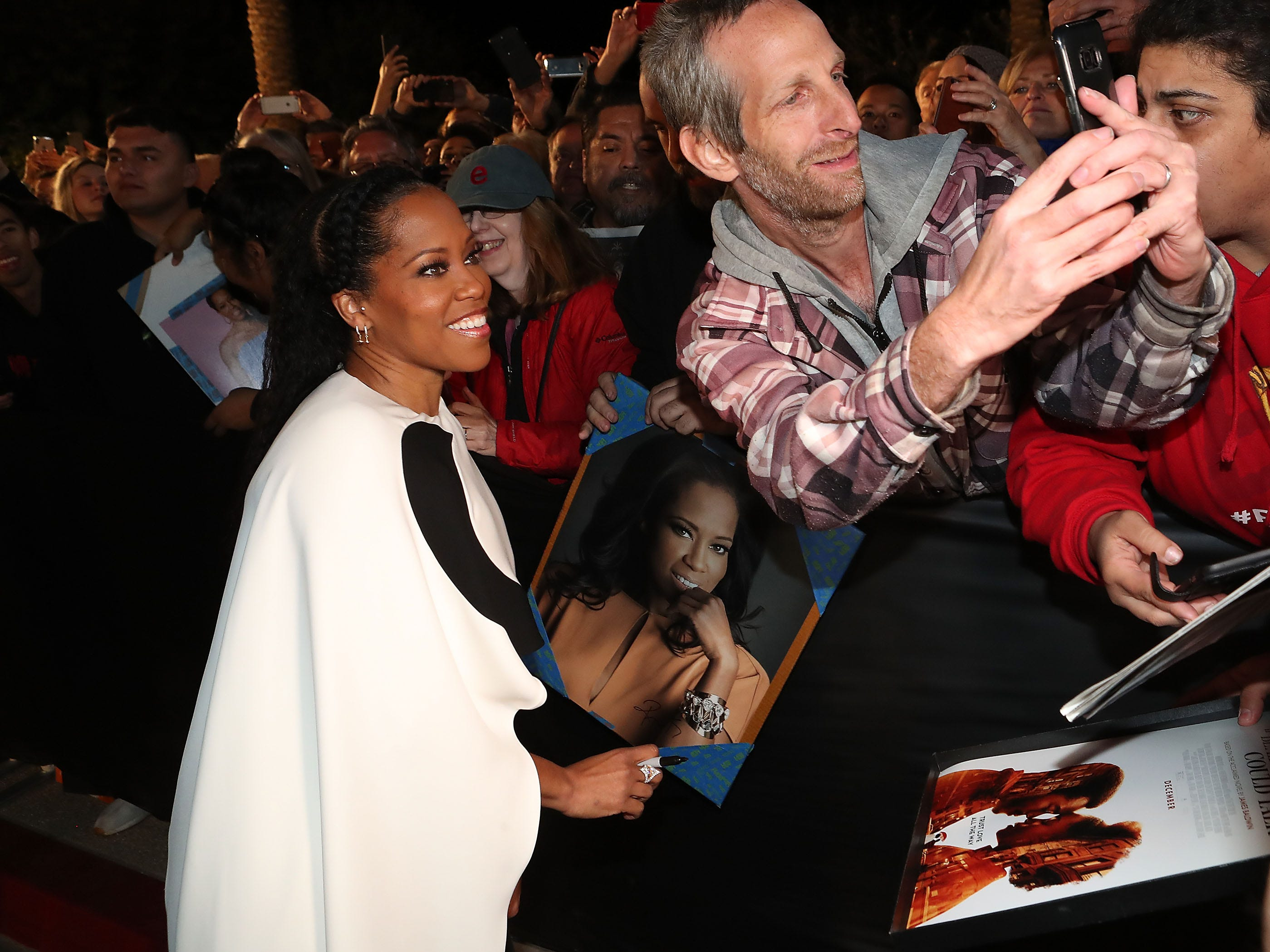 Regina King signs autographs at the Palm Springs International Film Festival Awards Gala, January 3, 2019.