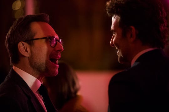 Christian Slater and Bradley Cooper enjoy a moment at the Palm Springs International Film Festival after-party at Parker Palm Springs.