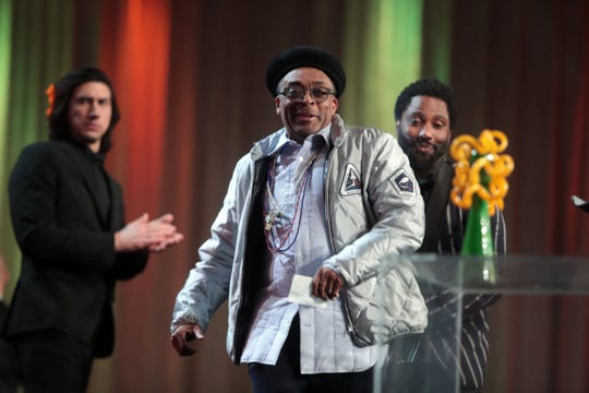 Spike Lee turns around to get his Career Achievement Award that he almost left on stage as Adam Driver and David Washington look on Thursday, January 3, 2018 at the Palm Springs International Film Festival Gala in Palm Springs.