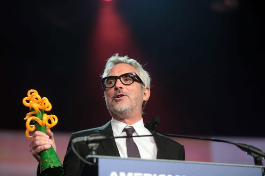 Alfonso Cuaron is presented with the Sonny Bono Visionary Award by Gary Oldman on Thursday, January 3, 2018 at the Palm Springs International Film Festival Gala in Palm Springs.