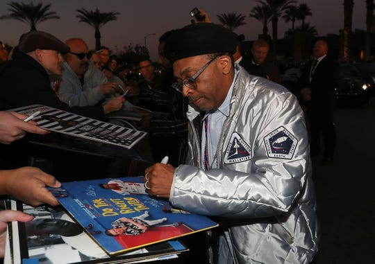 Spike Lee signs autographs for fans at the Palm Springs International Film Festival Awards Gala, January 3, 2019.