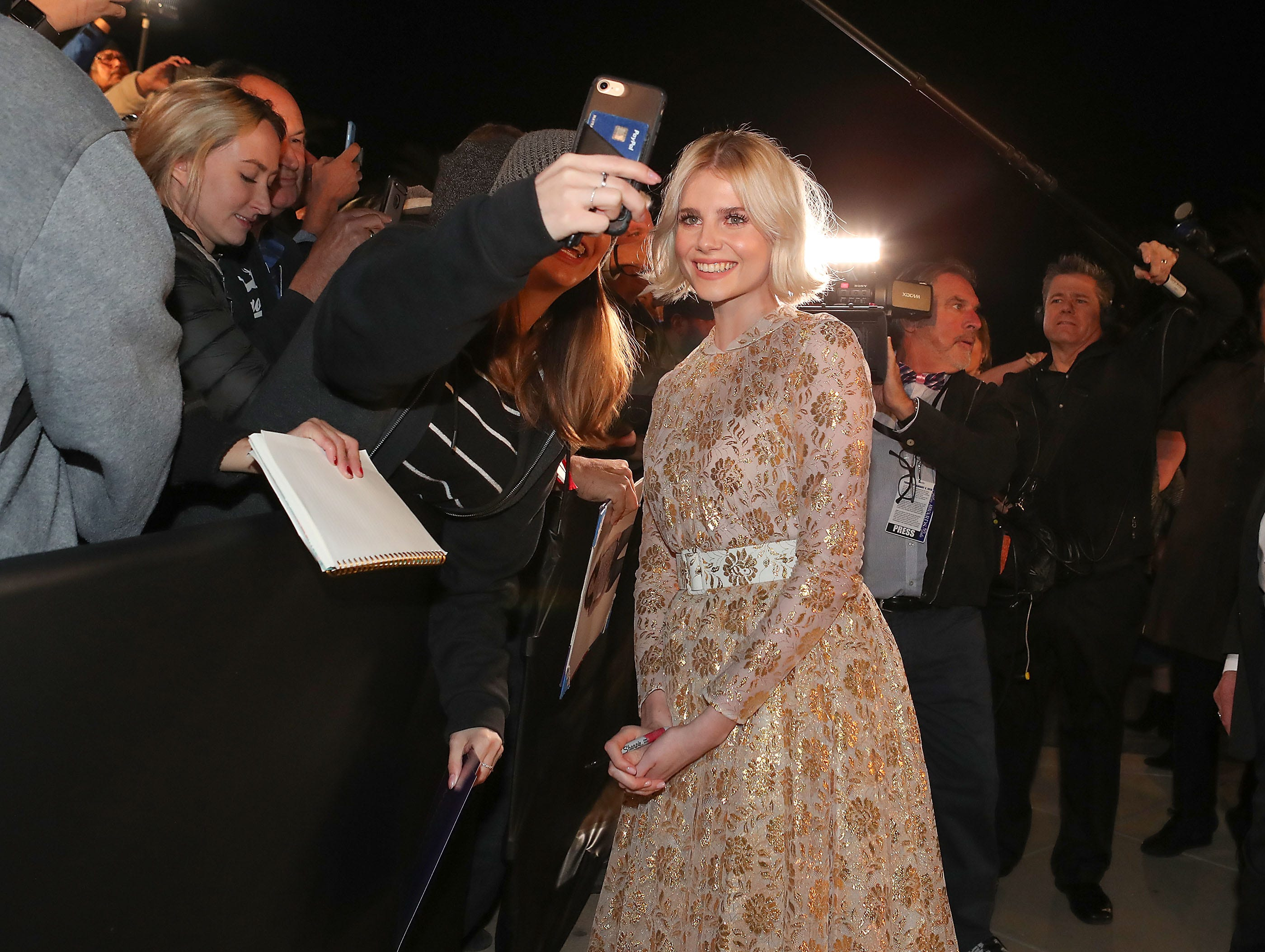 Lucy Boynton signs autographs for fans at the Palm Springs International Film Festival Awards Gala, January 3, 2019.