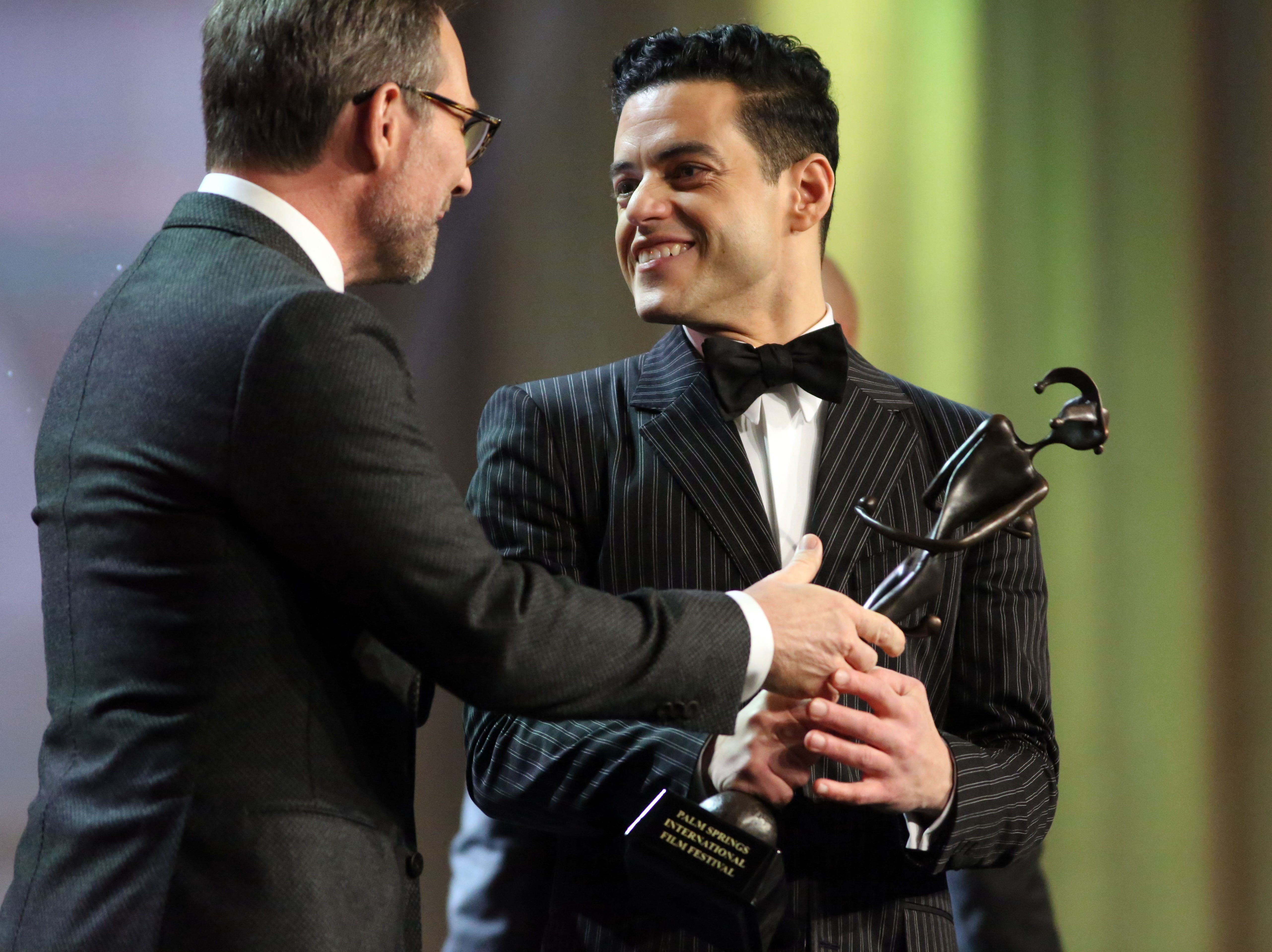 Rami Malek receives the Breakthrough Performance Award presented to him by Christian Slater on Thursday, January 3, 2018 at the Palm Springs International Film Festival Gala in Palm Springs.