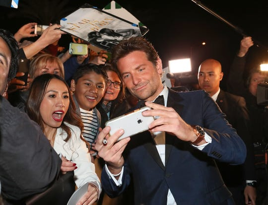 Bradley Cooper takes photos with fans at the Palm Springs International Film Festival Awards Gala, January 3, 2019.