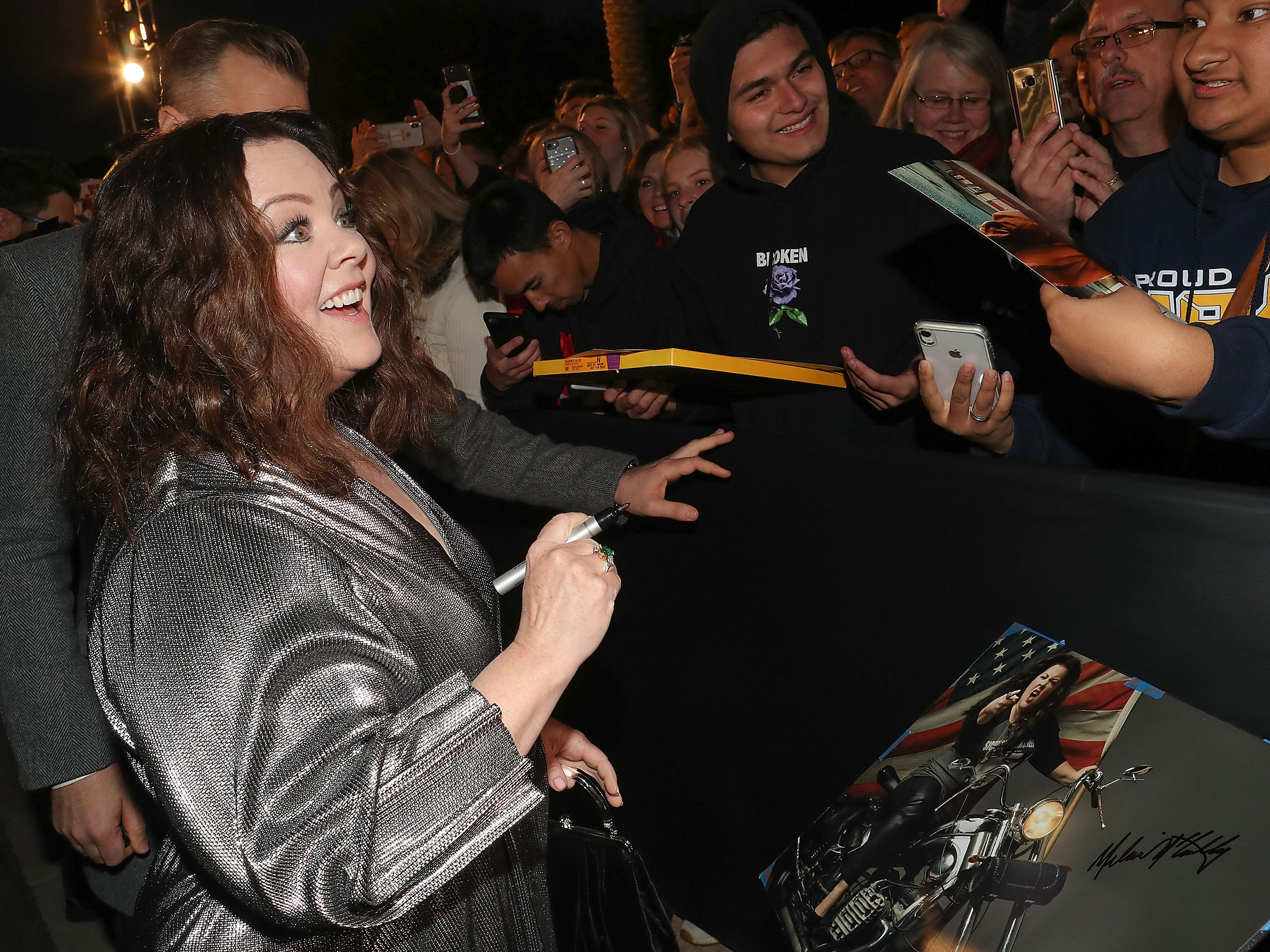 Melissa McCarthey signs autographs for fans at the Palm Springs International Film Festival Awards Gala, January 3, 2019.