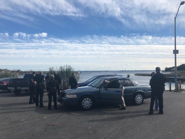 Authorities work Friday, Jan. 4, 2019, to recover a body found in Pensacola Bay near the fishing pier.