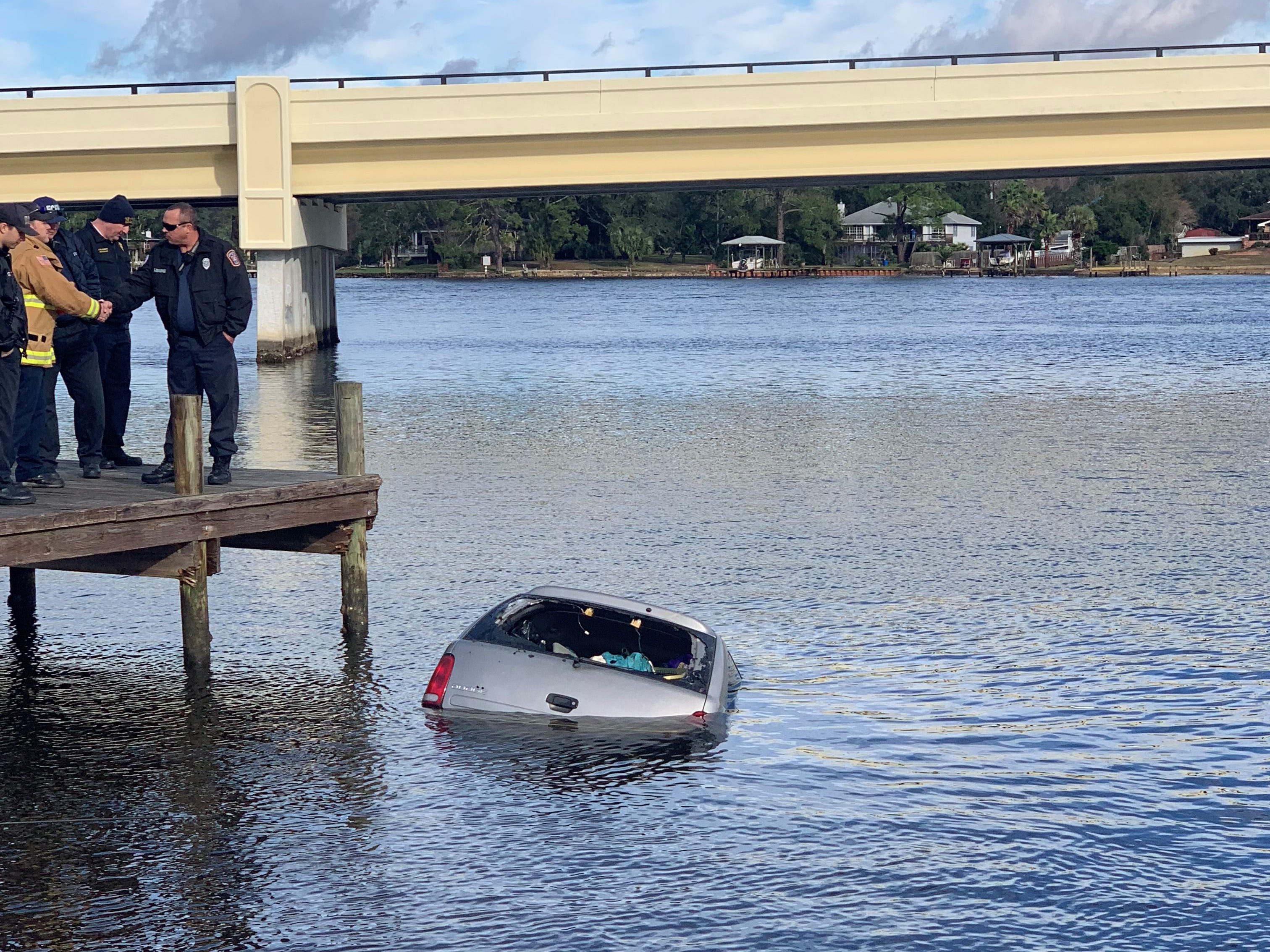 Authorities investigate a submerged vehicle found at the Navy Point Boat Ramp on Friday morning. Officials did not find any bodies in or around the car.