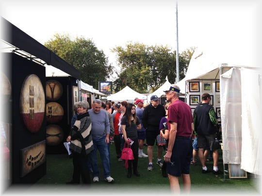 Visitors can peruse different mediums of art at the Surprise Fine Art and Wine Festival.