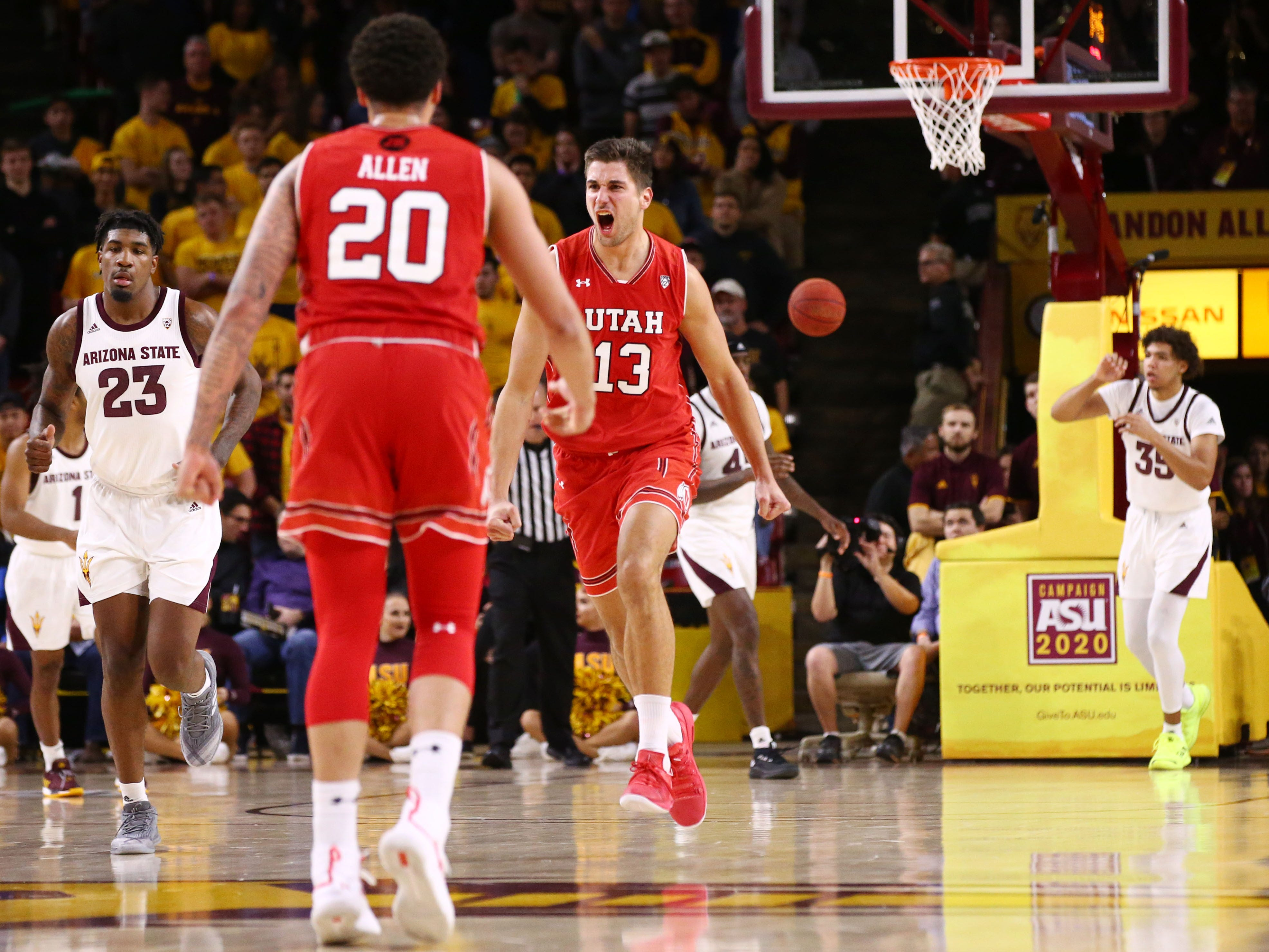 Utah Utes forward Novak Topalovic (13) reacts after a slam-dunks against the Arizona State Sun Devils in the second half on Jan. 3 at Wells Fargo Arena in Tempe.