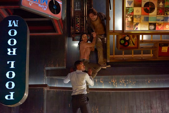 "In ""Escape Room,"" Ben (Logan Miller, from top), Zoey (Taylor Russell) and Jason (Jay Ellis) attempt to figure out the puzzle that keeps them trapped."