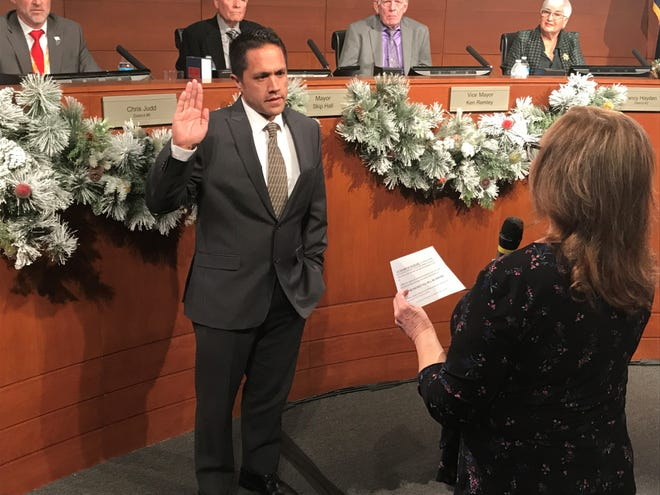 Surprise Councilman David Sanders is sworn in by city clerk Sherry Aguilar after being appointed by the Surprise City Council on Jan. 3, 2019.