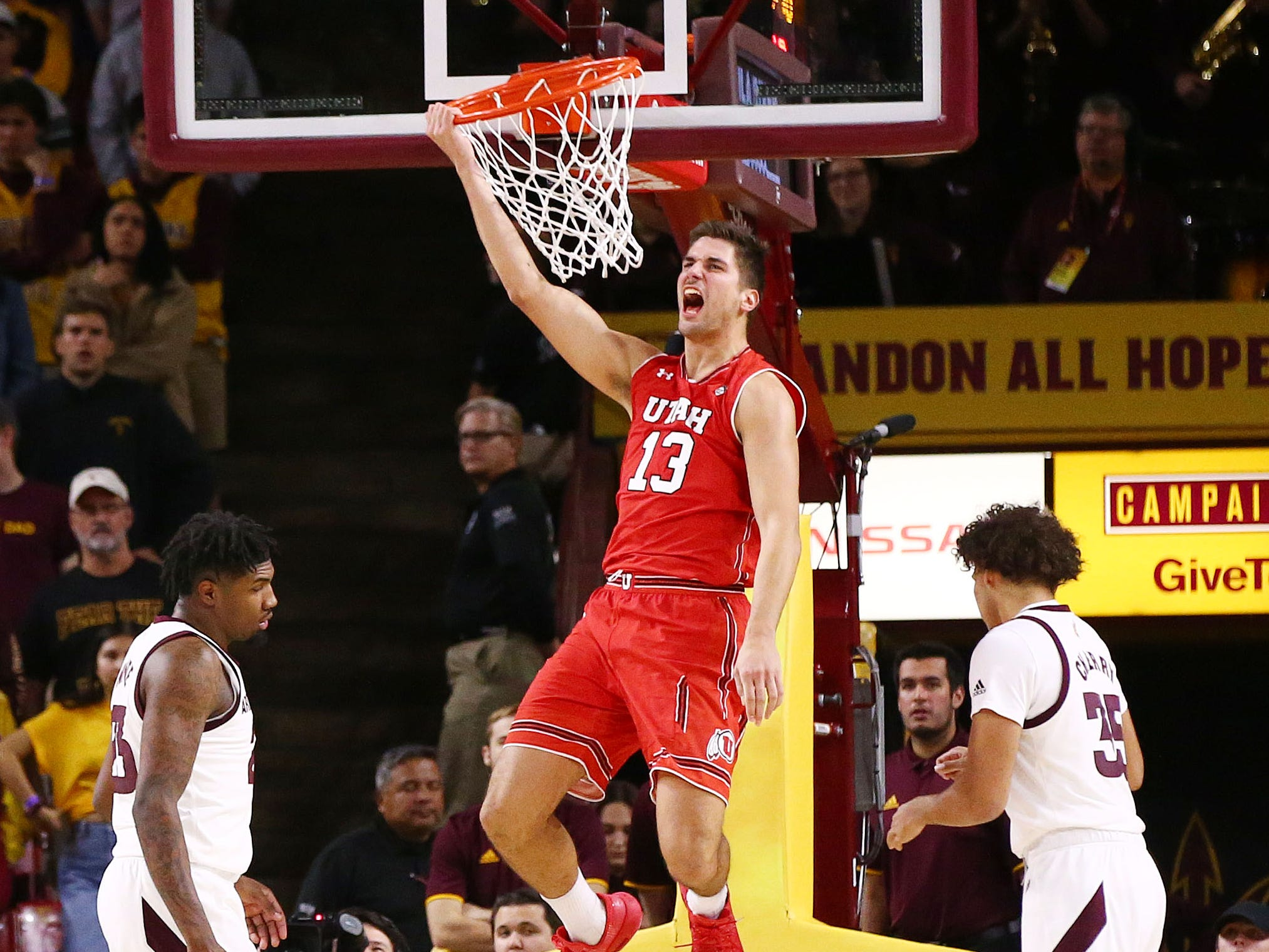 Utah Utes forward Novak Topalovic (13) slam-dunks the ball against the Arizona State Sun Devils in the second half on Jan. 3 at Wells Fargo Arena in Tempe.