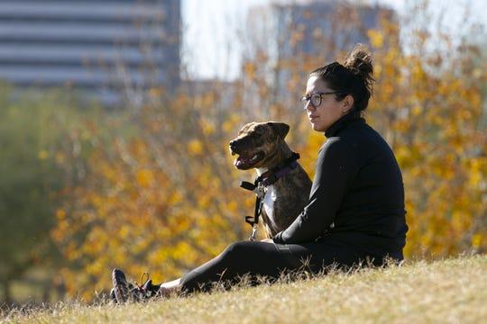 Mercedes Murrieta of Phoenix, hangs out with her dog Rita at Steele Indian School Park in Phoenix on Dec. 26, 2018.