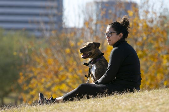 Mercedes Murrieta of Phoenix, hangs out with her dog Rita at Steele Indian School Park in Phoenix on Dec. 26, 2018.