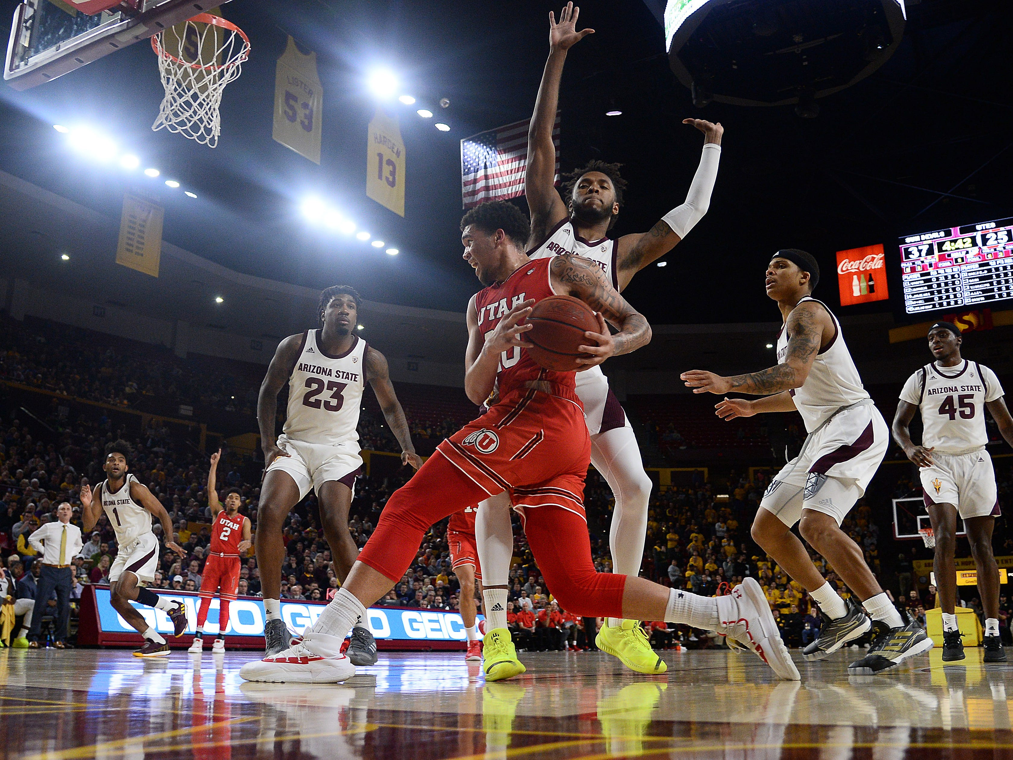 Jan 3, 2019; Tempe, AZ, USA; Utah Utes forward Timmy Allen (20) drives against Arizona State Sun Devils forward Kimani Lawrence (14) during the first half at Wells Fargo Arena (AZ). Mandatory Credit: Joe Camporeale-USA TODAY Sports