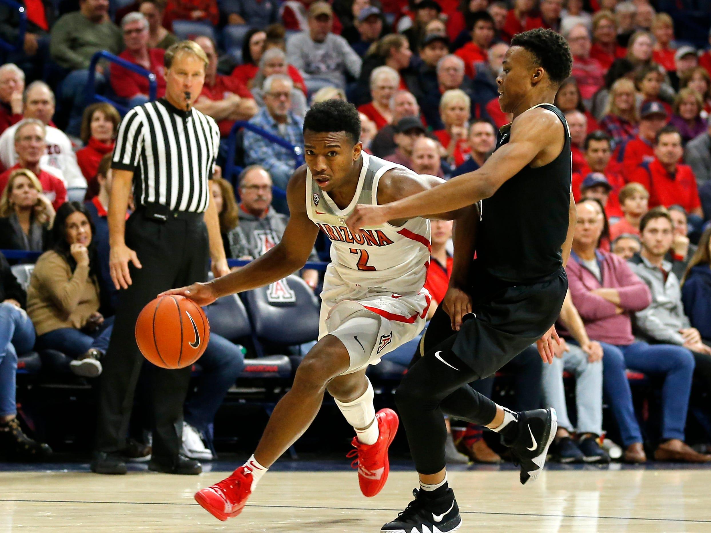 Arizona guard Brandon Williams (2) in the first half during an NCAA college basketball game against Colorado, Thursday, Jan. 3, 2019, in Tucson, Ariz. (AP Photo/Rick Scuteri)
