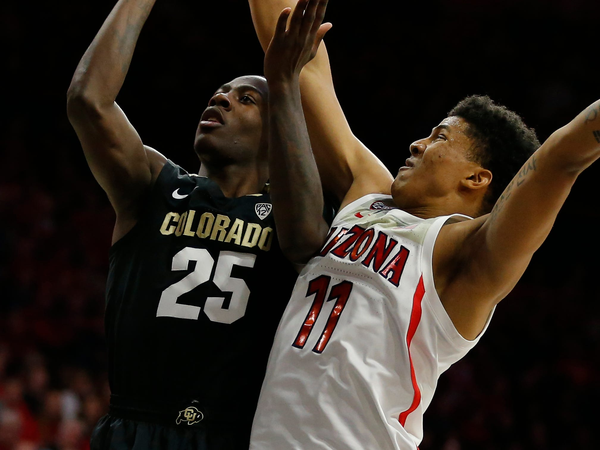 Arizona forward Ira Lee (11) blocks the shot of Colorado guard McKinley Wright IV in the first half during an NCAA college basketball game, Thursday, Jan. 3, 2019, in Tucson, Ariz. (AP Photo/Rick Scuteri)