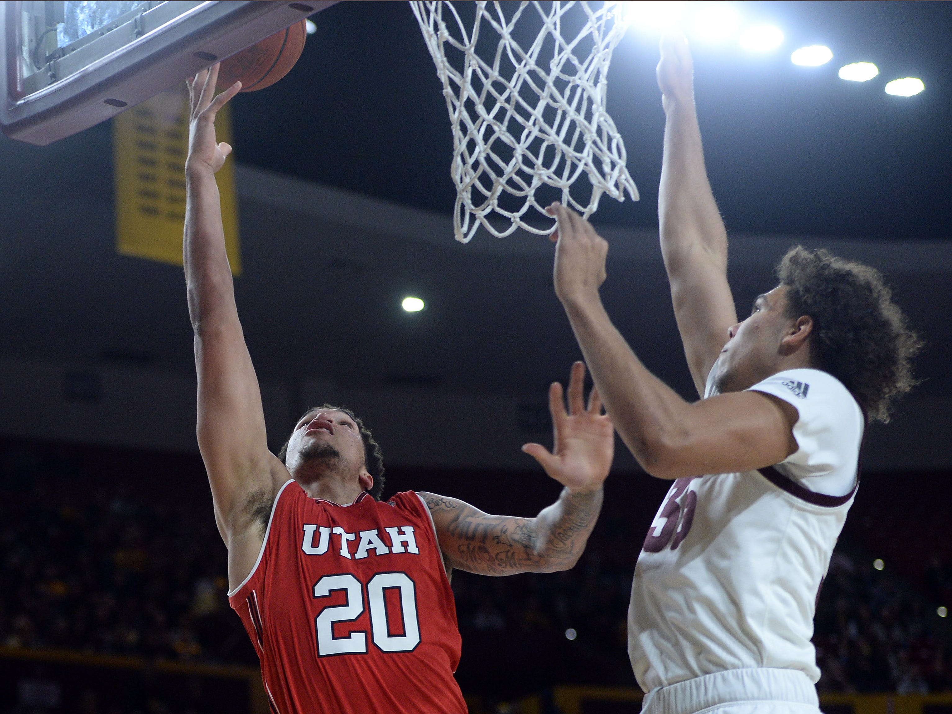 Jan 3, 2019; Tempe, AZ, USA; Utah Utes forward Timmy Allen (20) shoots the ball over Arizona State Sun Devils forward Taeshon Cherry (35) during the first half at Wells Fargo Arena (AZ). Mandatory Credit: Joe Camporeale-USA TODAY Sports