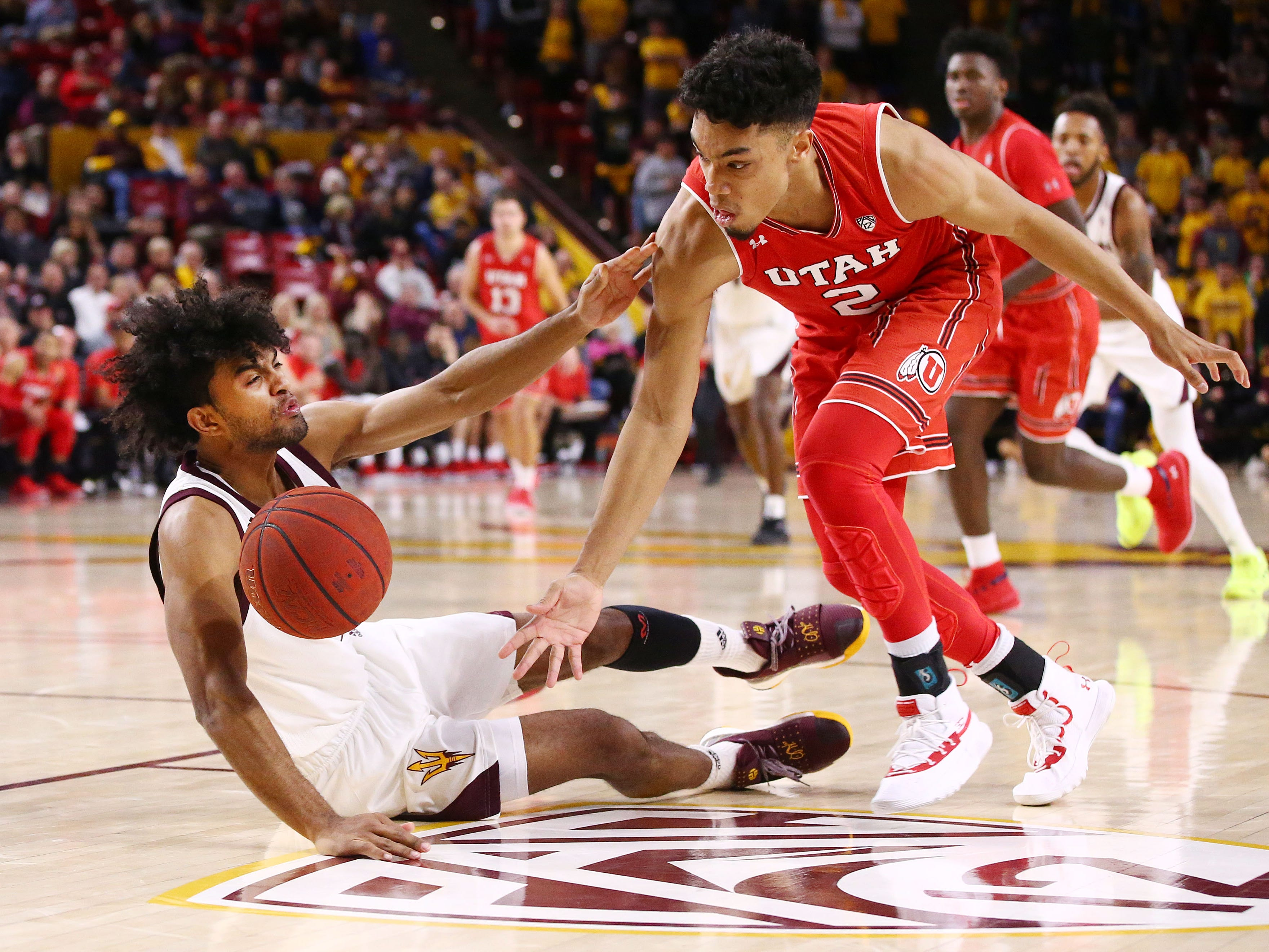 Arizona State Sun Devils guard Remy Martin battles for a loose ball with Utah Utes' Sedrick Barefield in the second half on Jan. 3 at Wells Fargo Arena in Tempe.