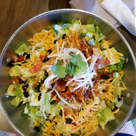 Grubstak's BBQ Chicken salad is made with chopped romaine, barbecue chicken, fire-roasted corn, black beans, tomatoes, jicama, cheddar cheese, Ranch dressing and cilantro.