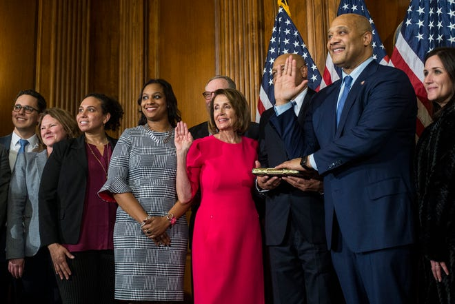 WASHINGTON, DC - JANUARY 03: Rep. André Carson (D-IN) takes part in a ceremonial swearing in ceremony with House Speaker Nancy Pelosi (D-CA)on January 3, 2019 in Washington, DC. Under the cloud of a partial federal government shutdown, Pelosi reclaimed her former title as speaker and her fellow Democrats took control of the House of Representatives for the second time in eight years. (Photo by Zach Gibson/Getty Images)