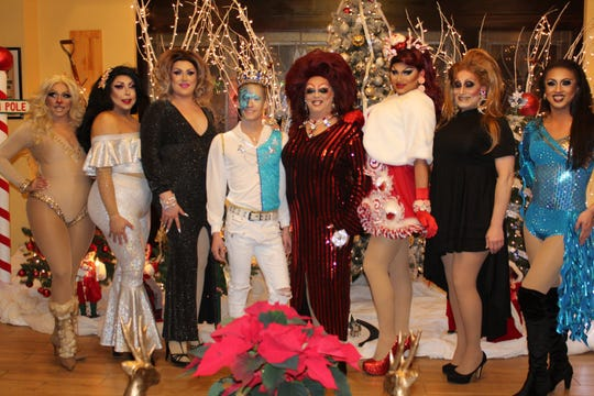 From left to right, Chrystal Le'Diamond, Lola Cha Cha, Angelica Kartier, Gage, Whitley Nycole DeAire', Amishka DeNile, Felicia Forrestor and Mia Ho perform at the Dec. 2018 Lebanon Drag Night.
