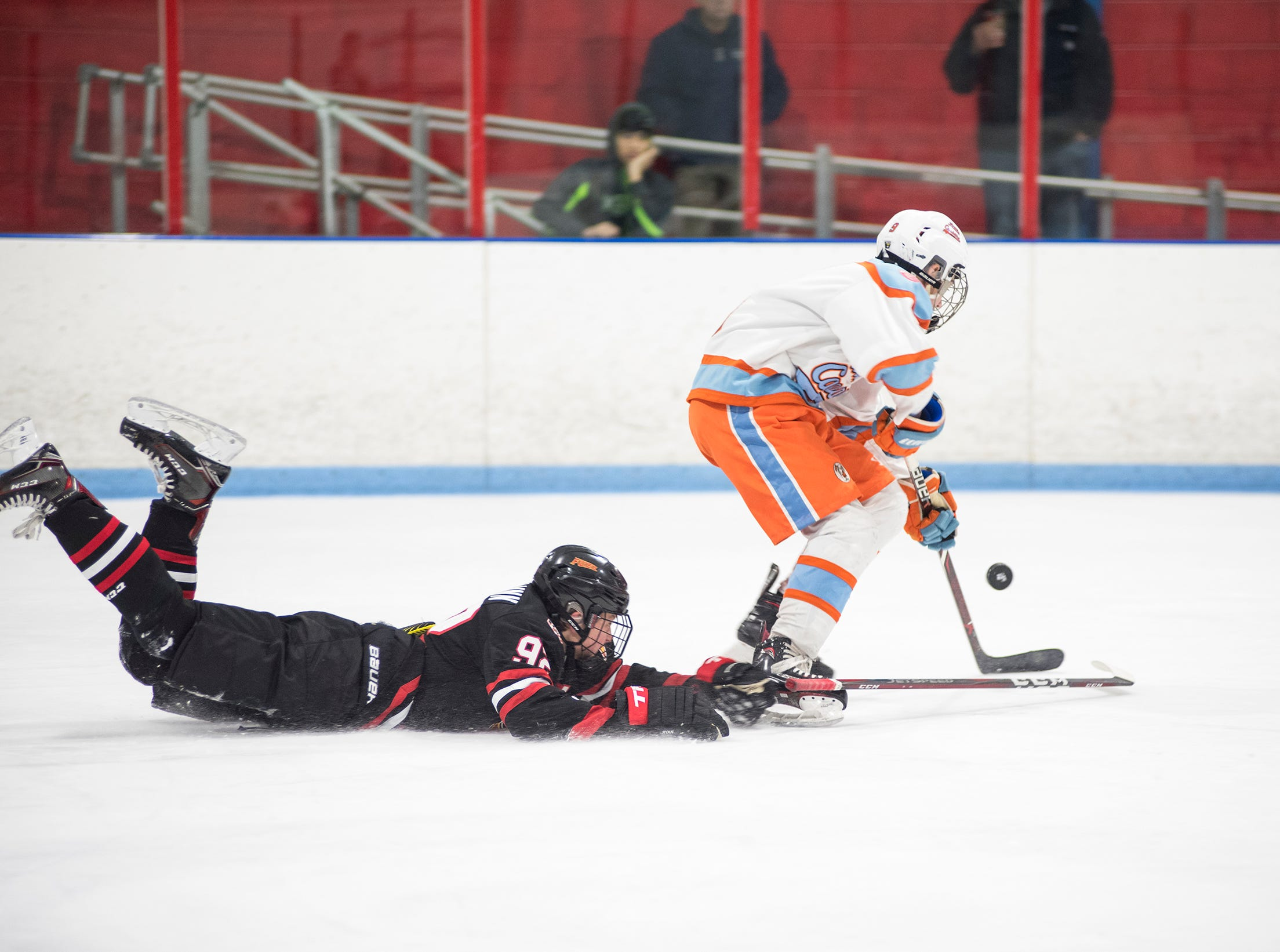 Indianapolis Jr Fuel defenseman JP O'Flynn (92) falls reaching to steal the puck from Detroit Little Caesars forward Michael Mesic during their BAAA-A Silver Stick Finals match Friday, Jan. 4, 2019 at Glacier Pointe Ice Complex.
