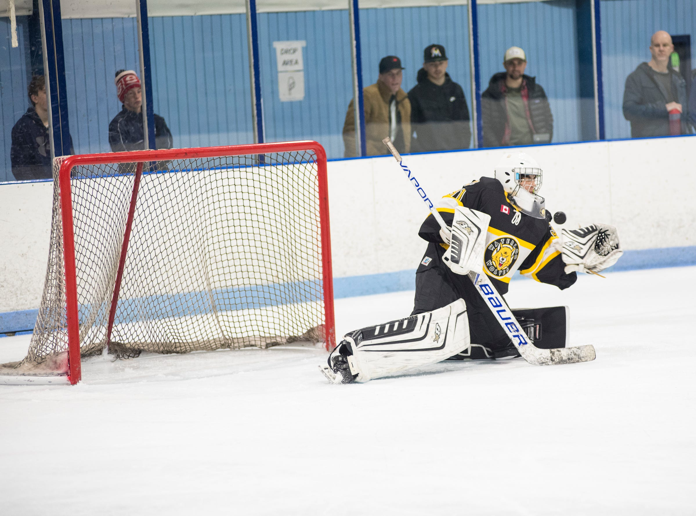 Waterloo Wolves goalie Richard Szajek reaches to block a shot during their BAAA-A Silver Stick Finals match against Don Mills Flyers Friday, Jan. 4, 2019 at Glacier Pointe Ice Complex.