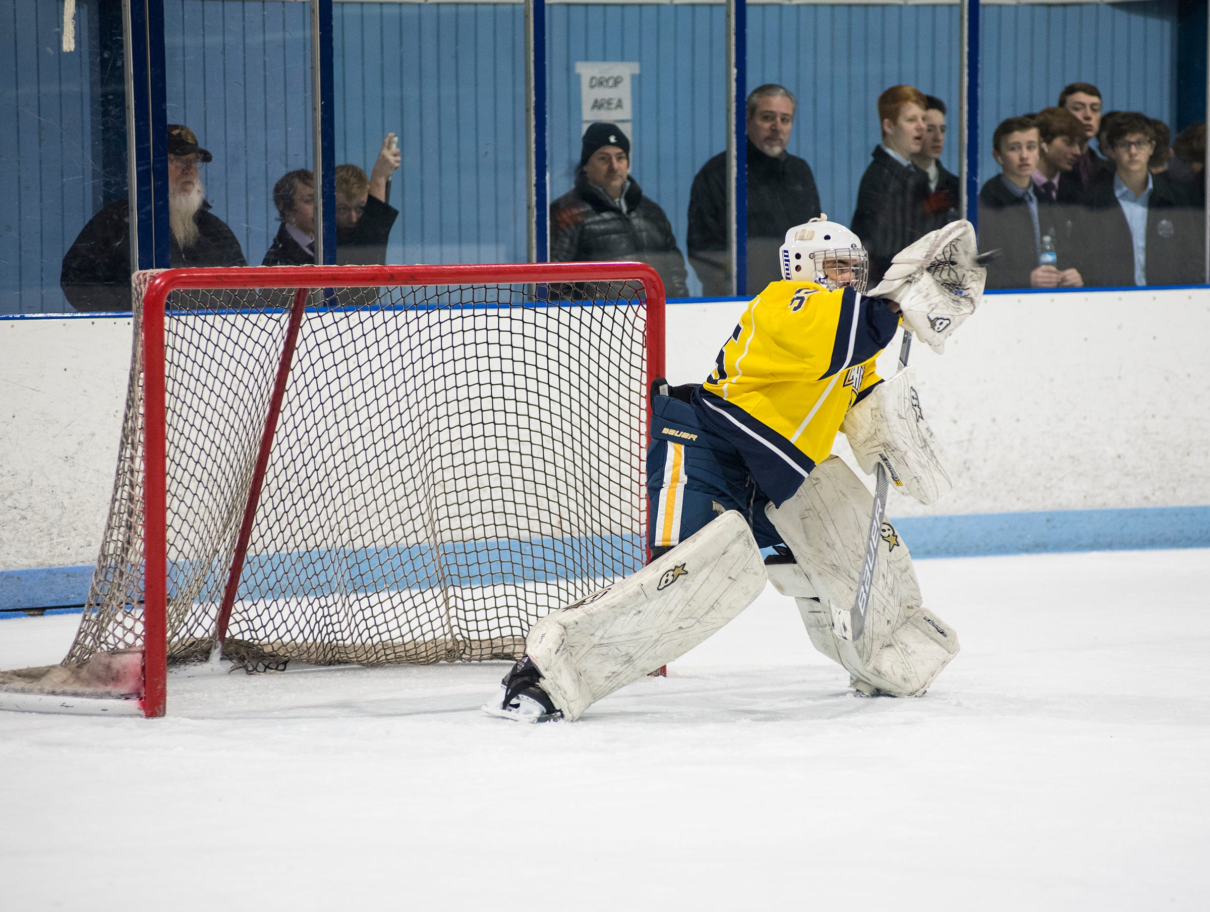 North Jersey Avalanche goalie Joseph Cartigiano catches the puck during their BAAA-E Silver Stick Finals match against Chicago Fury Friday, Jan. 4, 2019 at Glacier Pointe Ice Complex.