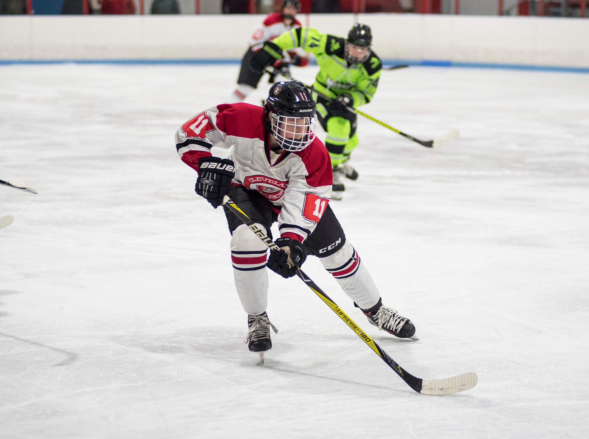 Cleveland Barons Elite forward Lance Mengel skates with the puck during their BAAA-C Silver Stick Finals match against Chicago Mission Friday, Jan. 4, 2019 at Glacier Pointe Ice Complex.