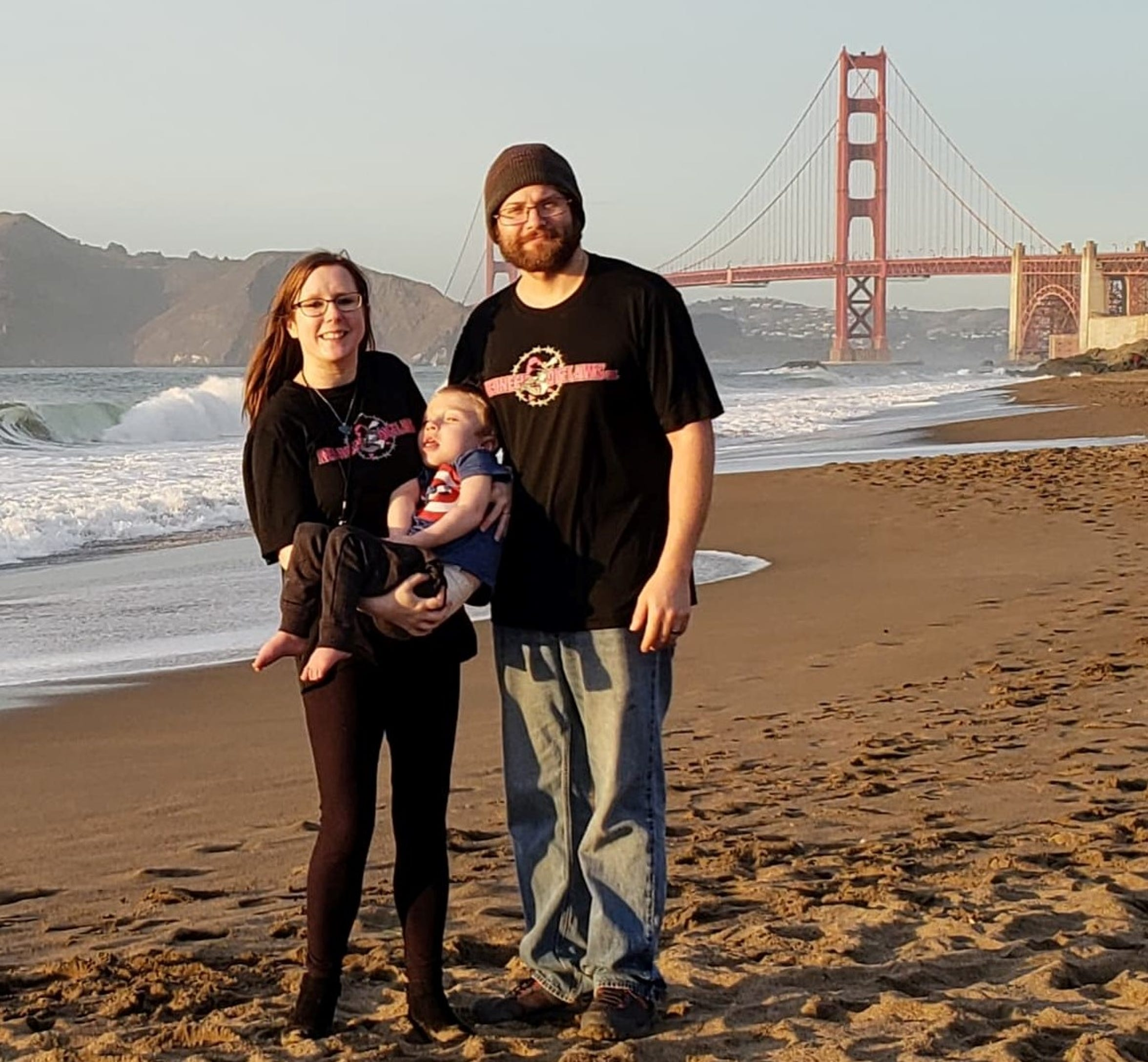 Laura, Logan and Cris Lacy, pictured in front of the Golden Gate Bridge in San Francisco, before Logan's gene therapy surgery on Dec. 18.