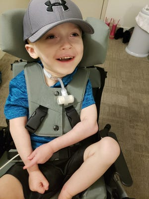 Logan Lacy, 4, has a genetic disorder that causes severe developmental delays. He requires a wheelchair. This photo was taken before a gene therapy surgery Dec. 18 that is meant to help him move, talk and hopefully one day talk.