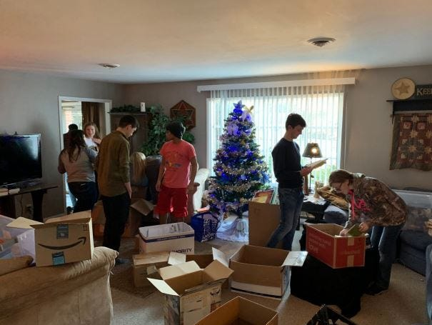 Students organize books at the Chastulik household. Kelton Chastulik, Chambersburg, hosted a book drive over the holidays to benefit libraries at homeless shelters and other facilities. The goal was 200 books, but 4,500 were raised.