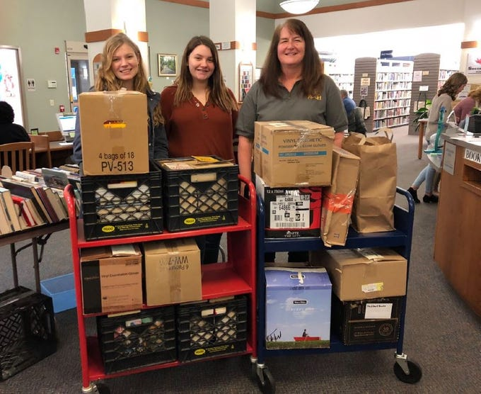 From left, Madison Mellinger, Kenedi Chastulik and Joan Peiffer, are pictured with a donation of books from Grove Family Library. Kelton Chastulik, Chambersburg, hosted a book drive over the holidays to benefit libraries at homeless shelters. The goal was 200 books, but 4,500 were raised.