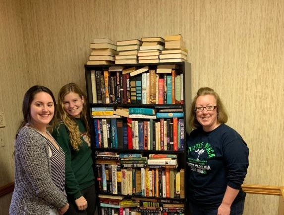 From left, Vanessa Hasanhodzic and Madison Mellinger with Amanda Garner of Adams County Literacy Council. Kelton Chastulik, Chambersburg, hosted a book drive over the holidays to benefit libraries at homeless shelters and other facilities. The goal was 200 books, but 4,500 were raised.