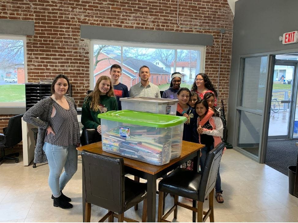 From left, Vanesa Hasanhodzic, Madison Mellinger, Andrew Feldman and Ben Raber with a group of students at NETwork Ministries and their donated books. Kelton Chastulik, Chambersburg, hosted a book drive over the holidays to benefit libraries at homeless shelters. The goal was 200 books, but 4,500 were raised.