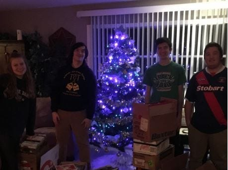 From left, Madison Melliner, Kyle Chastulik, Andrew Feldman and Collin Owens count books on the first day. Kelton Chastulik, Chambersburg, hosted a book drive over the holidays to benefit libraries at homeless shelters and other facilities.Kelton Chastulik, Chambersburg, hosted a book drive over the holidays to benefit libraries at homeless shelters and other facilities.
