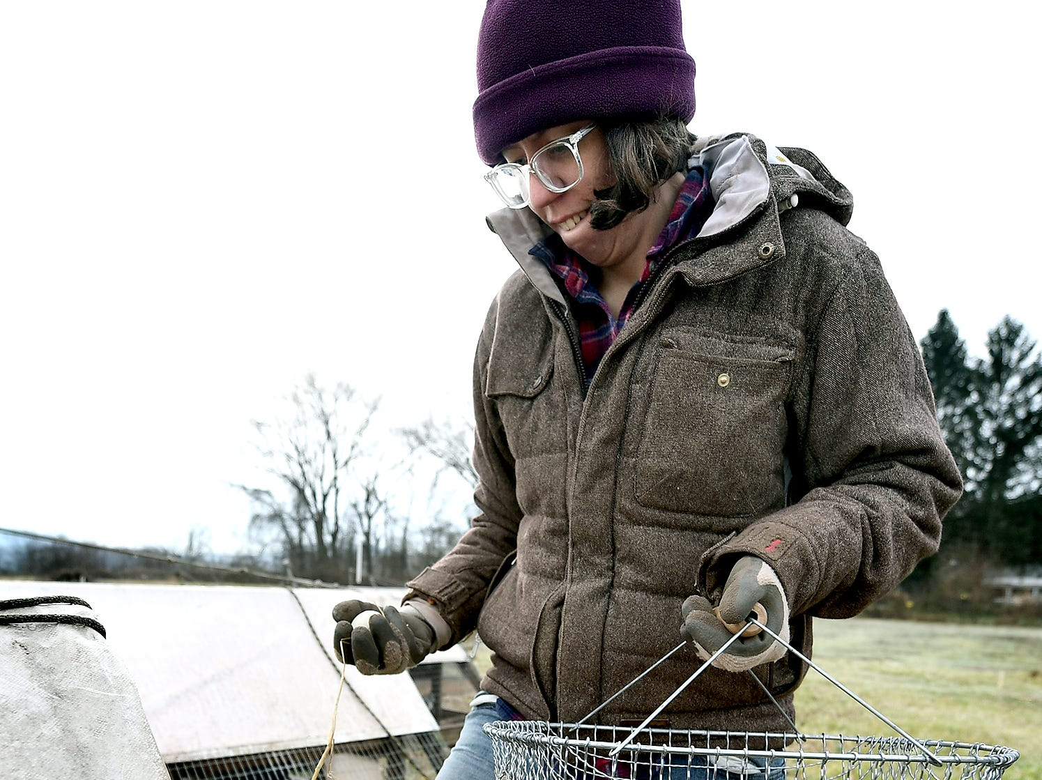 Claire O'Brien collects eggs at her family's sustainable Sunnyside Farm in Newberry Township Friday, Jan. 4, 2019. Bill Kalina photo