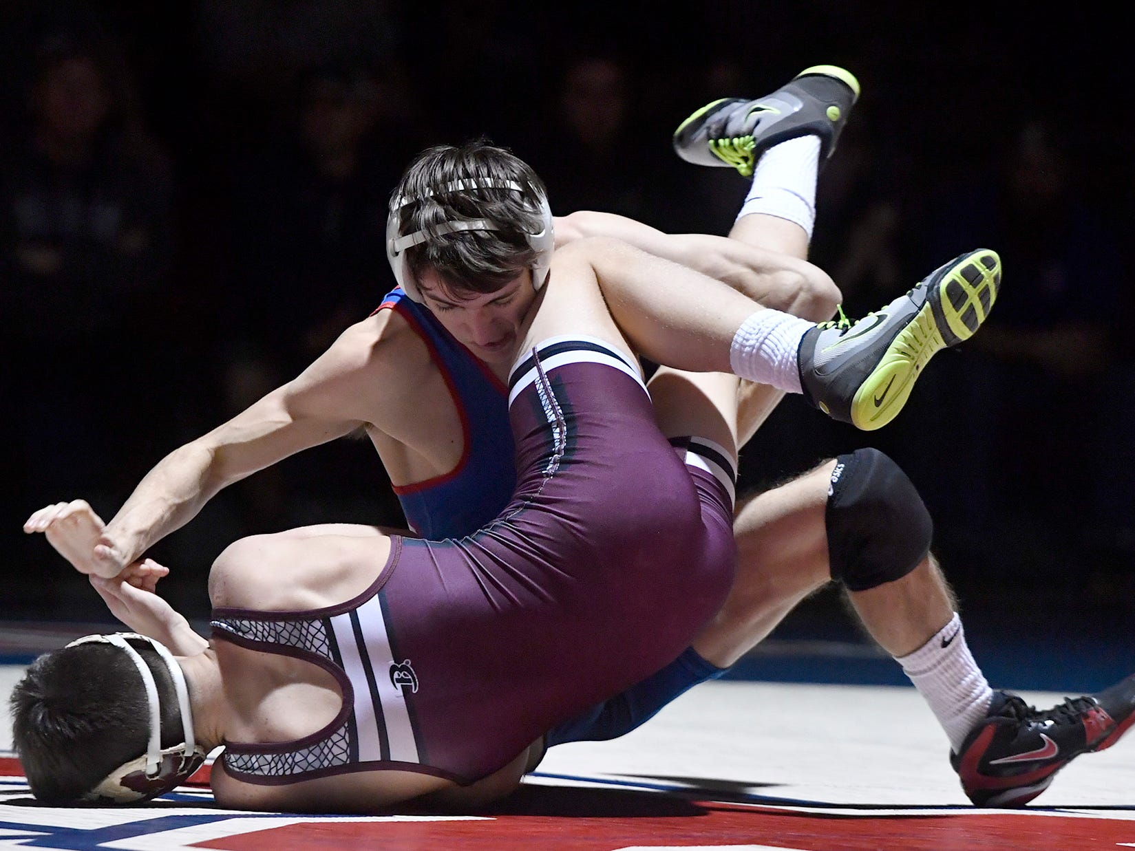 Charles Styk of Spring Grove tries to roll Gettysburg's Ethan Dalton to his back during the 120 pound match, Thursday, January 3, 2019
