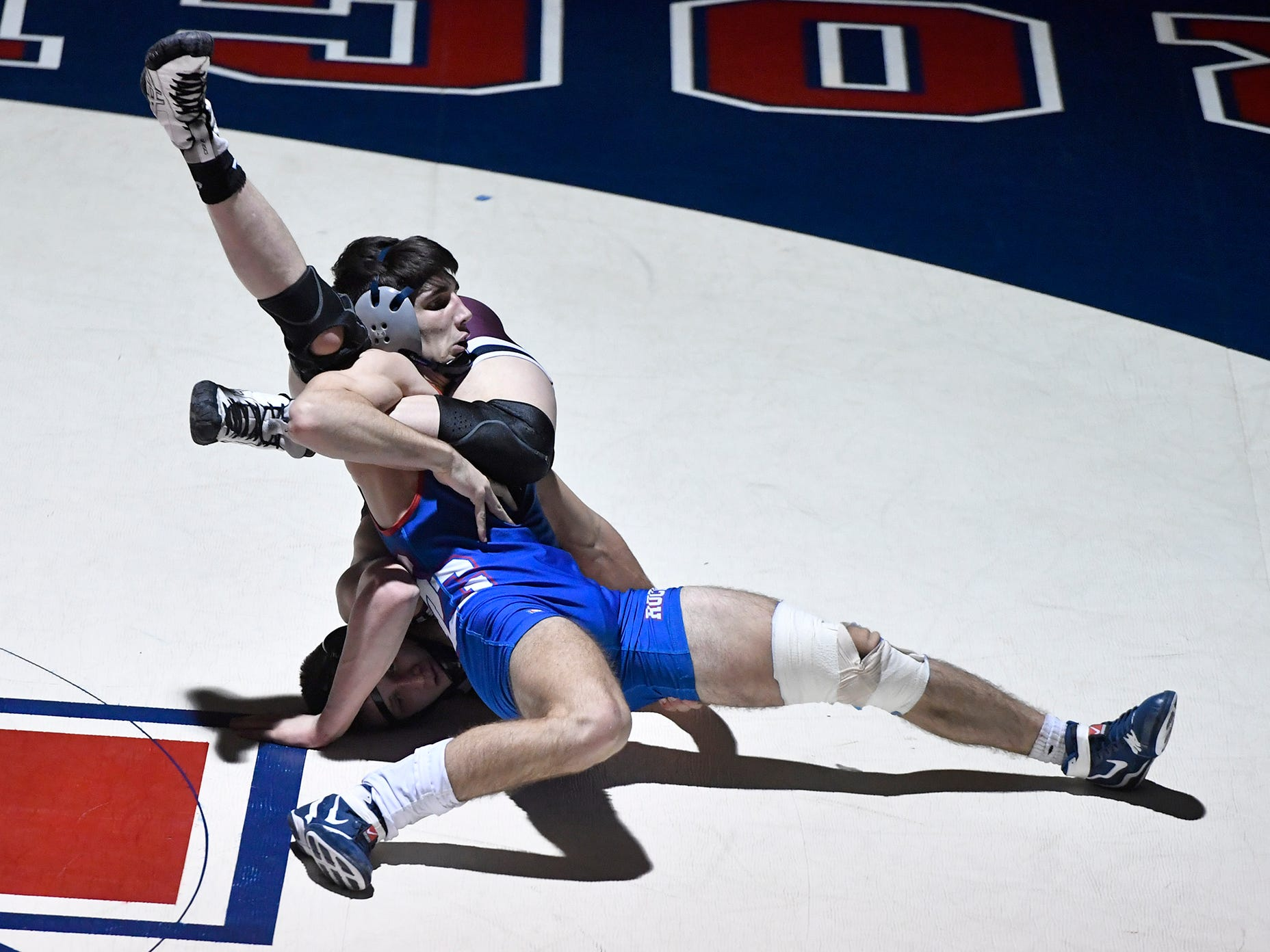 Dylan Reinert of Gettysburg and Spring Grove's Anthony Hinson tangle up during the 160 pound match, Thursday, January 3, 2019