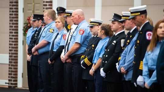 Emergency personnel line up before Robert Kohler Sr.'s coffin is walked to the ambulance for the last ride, January 4, 2018.