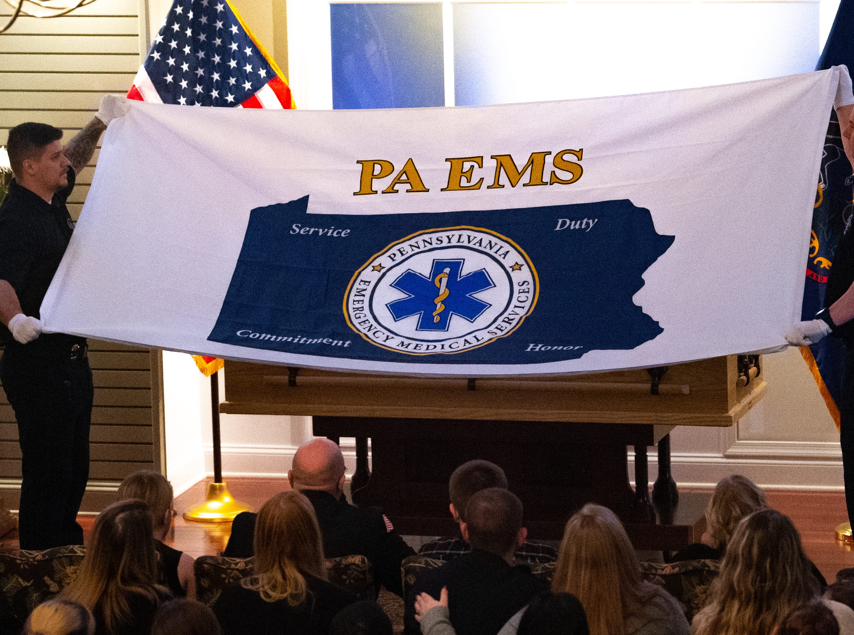 An EMS flag was placed on Robert Kohler Sr.'s coffin  during the funeral, January 4, 2019.