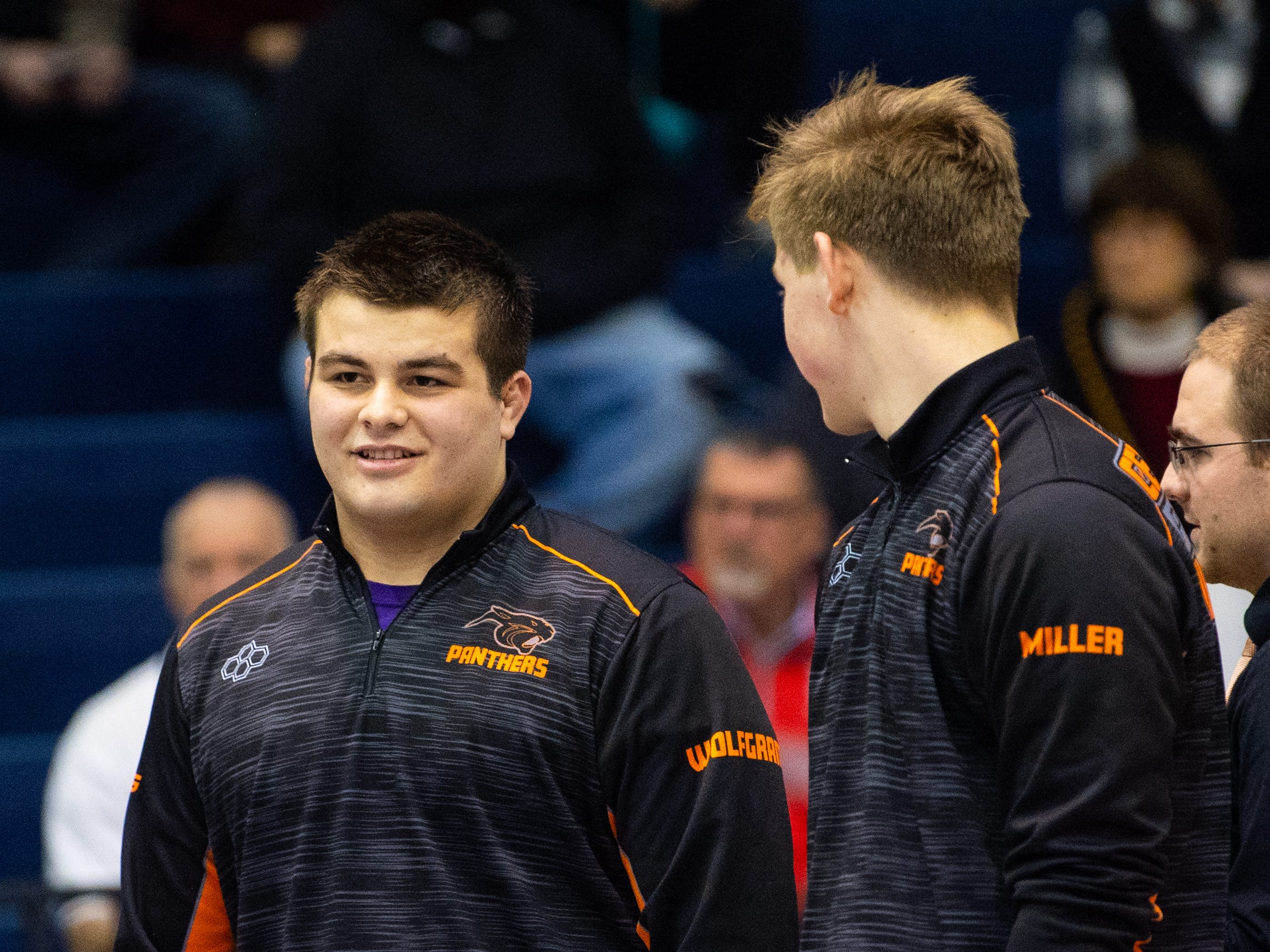 Michael Wolfgram (left) and Ethan Miller (right) of Central York discuss strategy during the wrestling dual meet between Dallastown and Central York at Dallastown Area High School, Thursday, January 3, 2019. The Wildcats defeated the Panthers 62-18.